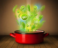 Bio signs coming out from cooking pot Stock Images