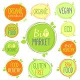 Bio sistema del icono del vector de etiquetas, de sellos o de etiquetas engomadas con las muestras - el bio mercado, gluten libre ilustración del vector