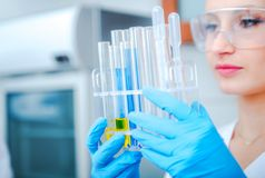 Bio Technology Research Concept. Female Research Technician in the Chemical Laboratory Stock Image