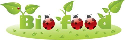 Bio- titolo del testo dell'alimento con i ladybugs Fotografie Stock Libere da Diritti