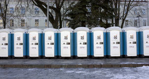 Bio toilets on a city street. VILNIUS, LITHUANIA - NOVEMBER 29, 2014: Bio toilets on a main square. The city is ready to celebrate Christmas. Toi Toi  brand Royalty Free Stock Photo