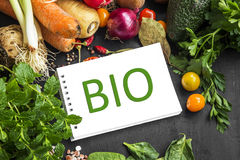 Bio vegetables and greens frame with bio note in centre Stock Image
