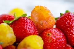 Bio yellow raspberries with red strawberries. close up. Bio yellow raspberries with bio red strawberries close up Stock Photo