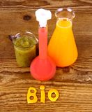 Biochemistry concept and juices from test tube stock image