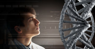 Biochemistry study and research . Mixed media. Man scientist and 3D rendering DNA molecule image at media screen Stock Image