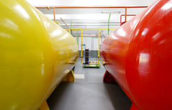 Biodiesel tanks inside factory. Red and yellow oil tanks in a biodiesel factory Stock Photos