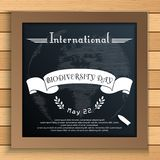 Biodiversity international day with Earth and white ribbon on blackboard. Illustration of Biodiversity international day with Earth and white ribbon on Stock Photography