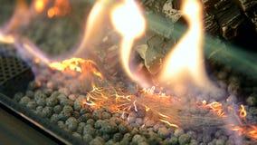 Modern bio fireplot on ethanol gas close-up. Biofireplace burn on ethanol gas. Contemporary mount biofuel on ethanol fireplot fireplace close-up. Decorated bio stock video