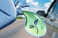 Biofuel. The canister with a drop of gasoline and a plant in it. Concept of non-polluting fuel Stock Photo