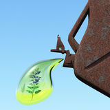 Biofuel. The canister with a drop of gasoline and a plant in it. Concept of non-polluting fuel Stock Image
