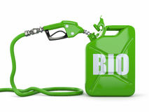Biofuel. Gas pump nozzle and jerrycan Stock Image