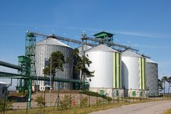 Biofuel tanks. Multiple white biofuel tanks with green and yellow stripes Royalty Free Stock Photos
