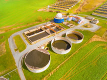 The biogas plant. Aerial view to biogas plant from pig farm in green fields. Renewable energy from biomass. Modern agriculture in Czech Republic and European Royalty Free Stock Photos