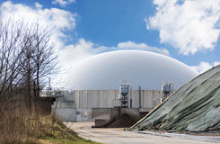 Biogas plant. Against blue sky with clouds, copy space Royalty Free Stock Photography