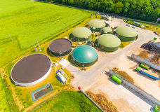 Biogas plant and farm. Aerial view over biogas plant and farm in green fields. Renewable energy from biomass. Modern agriculture in Czech Republic and European Royalty Free Stock Photography