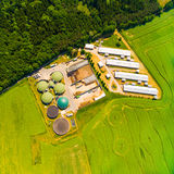 Biogas plant and farm. Royalty Free Stock Images