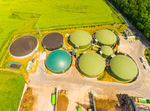 Biogas plant and farm. Aerial view over biogas plant and farm in green fields. Renewable energy from biomass. Modern agriculture in Czech Republic and European Stock Photo