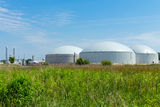 Biogas plant. A biogas plant under a blue sky Royalty Free Stock Images