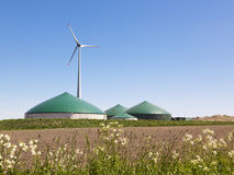Biogas plant and wind turbine. In rural Germany Royalty Free Stock Photo