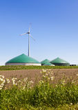 Biogas plant and wind turbine. In rural Germany Royalty Free Stock Photography
