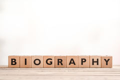 Biography headline sign on a table. Biography headline sign made of wood on a table stock photo