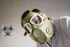 Biohazadrous shots. Face with gas mask and medical gown royalty free stock photo
