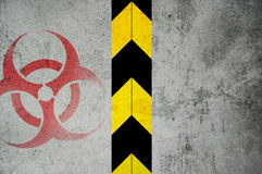 Biohazard. Metal closed door with warning - black yellow stripes and red biohazard symbol Stock Images
