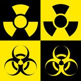 Biohazard. Radio active and biohazard sign on yellow and black Stock Images