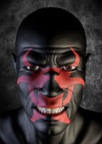 Biohazard bogeyman. 3D render of scary male face with biohazard symbol painted on Stock Image