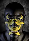 Biohazard bogeyman. 3D render of scary male face with biohazard symbol painted on Stock Photos