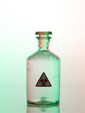 Biohazard bottle with green light. Danger Royalty Free Stock Photo