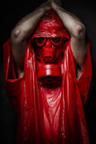 Biohazard concept, man with red gas mask. Royalty Free Stock Images