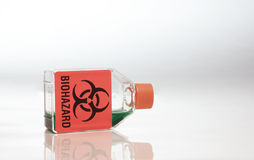 Biohazard Container. Flask full with a biohazard chemical Stock Photos
