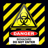 Biohazard danger sign. Biohazard, danger sign warning with stripes background Stock Image
