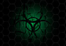 Biohazard dark green symbol behind mesh metal Royalty Free Stock Photo
