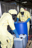 Biohazard experts disposing infested material Stock Image