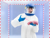 Biohazard geared person injecting raw meat Stock Images