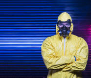 Biohazard. A man in full biological suit with mask Stock Photos