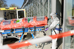 Biohazard medical team member with stretcher Royalty Free Stock Images
