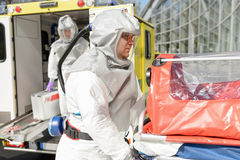 Biohazard medical team member with stretcher Stock Images