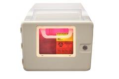 Biohazard sharps disposal box. Biohazard sharps and needle disposal box isolated on a white background Stock Image