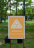 Biohazard sign with text: Warning! Danger of infection. Warning radiation hazard. Warning sign. royalty free stock image