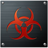 Biohazard Symbol. An engraved biohazard symbol on a brushed metal plate Stock Photo