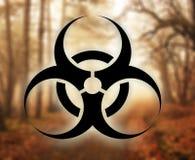 Biohazard. Symbol against nature background royalty free illustration