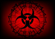 Biohazard symbol and  barbed wire on red background Royalty Free Stock Photo