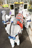 Biohazard team loading stretcher in ambulance Royalty Free Stock Photos