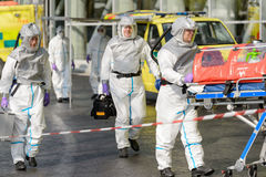 Biohazard team with stretcher walking on street Royalty Free Stock Photos