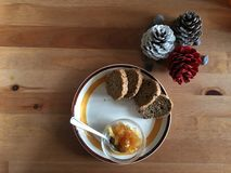 Biologiacal breakfast with jam brown bread and pine cones colored Royalty Free Stock Images