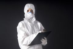 Biologic dress protection with A or swine flu. Biologic danger dress protection with A or swine flu royalty free stock image