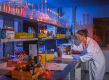 Biological laboratory. Young scientist working in modern biological lab Stock Images